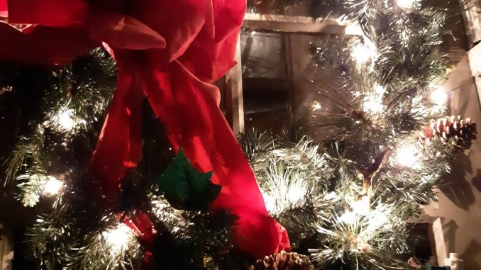 Lighted Christmas wreath on door